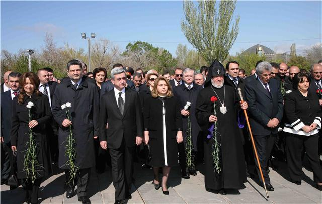 The memorial is a moving testiment to those who suffered and lost their lives in this horrific event in history and includes ashes of victims gathered from Armenia by Father Jirayr three years ago. Father Jirayr sang prayers and together we lit candles and prayed for the victims, for their families and for the people of Armenia  today and their future.After the service we were given wonderful hospitality, a sign of the  friendship and fellowship  which has developed betwen St Chrysostom's and the Armenian Church,  as we shared in Armenian coffee, chocolates and conversation.  The President of Armenia together with the Armenian Ka gather to lay flowers at the Memorial in Yerevan