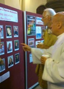 Keep an eye an that one! Fr Ian and Bishop David looking at the parish assistant display