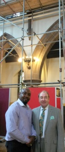 Our churchwardens in front of scaffolding set up to help look at damp problems.