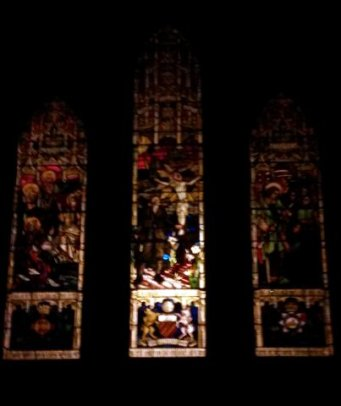 The Walter Pierce window in the Anson Chapel from outside, at night
