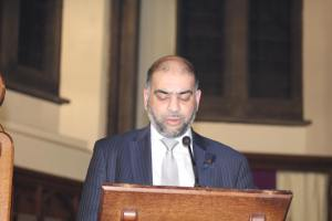Councillor Rabnawaz Akbar reading at the Parish Carol Service